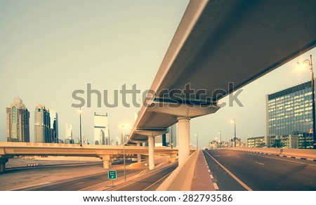 Roads and bridge at the Sheikh Zayed Road in Dubai in the evening, United Arab Emirates - stock photo