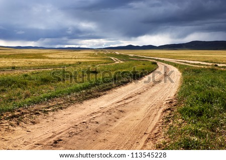 Roads in the desert steppes of Mongolia and the storm sky