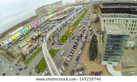 Roads of highways and railway with electric train near the telecentre, view from unmanned quadrocopter. - stock photo