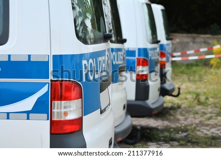 roadside parked police car while a police operation in the city of Magdeburg - stock photo