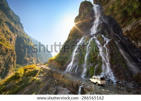 Roadside waterfall. Nepal, Himalayas, Annapurna Conservation Area. - stock photo