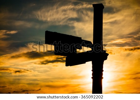 Roadsign at dusk - stock photo