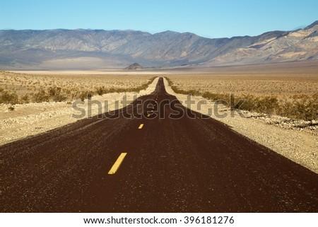 Roadway in desert near death valley, california - stock photo