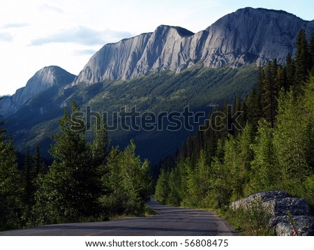 Roadway in the mountains .... Jasper National Park, near Miette Hot Spring - stock photo