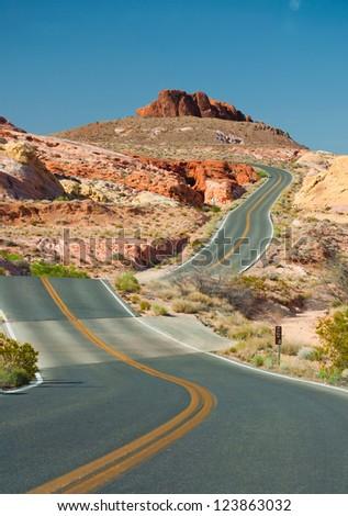 roadway through desert - stock photo