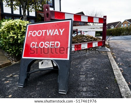 Roadworks; footway closed sign and barriers