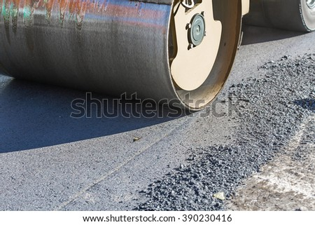 Roadworks on laying of a new of asphalt - stock photo