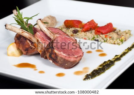 Roast Australian Lamb with couscous and basil - stock photo