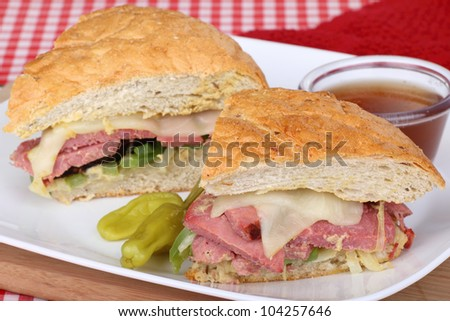 Roast beef and cheese sandwich on a plate