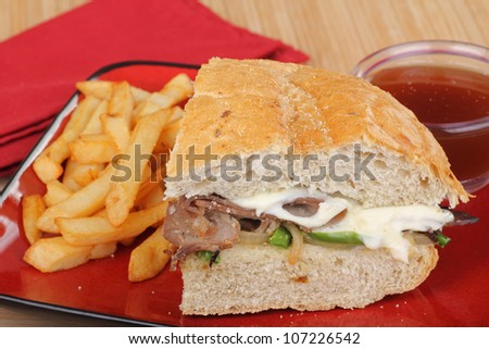 Roast beef and cheese sandwich with french fries