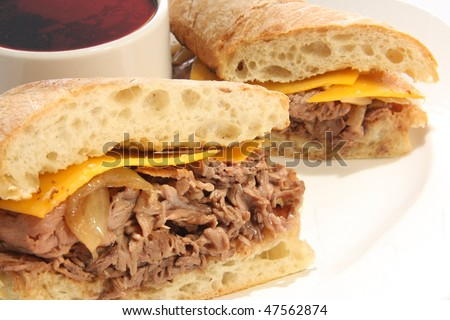 Roast Beef dip sandwich with cheese.