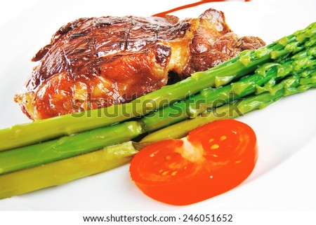 roast beef meat served with asparagus on white - stock photo