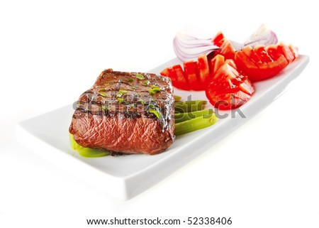 roast beef meat served with tomato on ceramic - stock photo