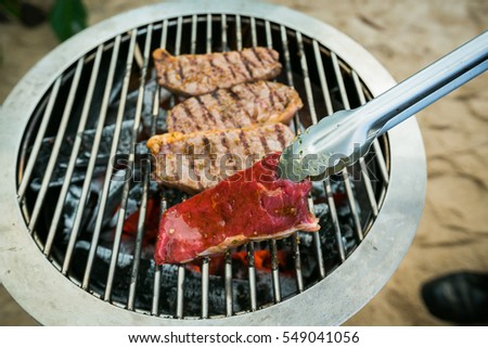 roast beef on barbecue grill cooked dinner,selective focus