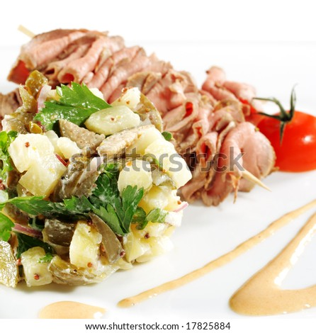 Roast Beef Served with Salad (Potatoes and Vegetables) and Cherry Tomato. Isolated on White Background