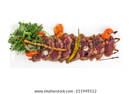 Roast beef with vegetables isolated on white background. Clipping path - stock photo