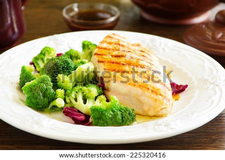 Roast breast grilled with salad with broccoli - stock photo