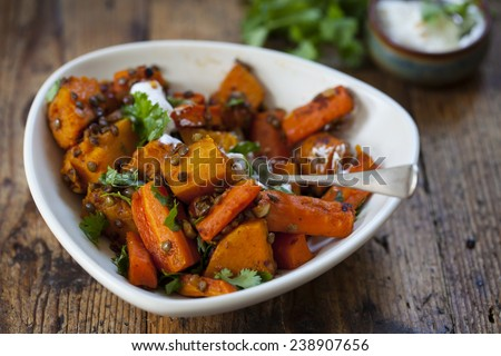 Roast butternut squash, carrots and lentils - stock photo