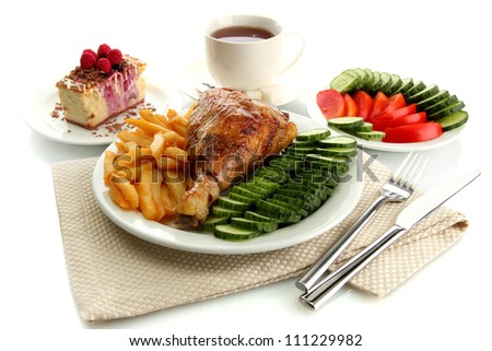 Roast chicken cutlet with boiled potatoes and  vegetables, cup of tea and dessert, isolated on white - stock photo