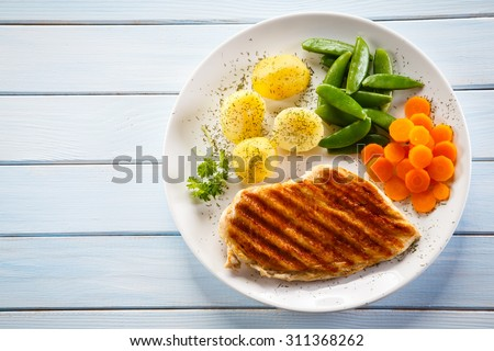 Roast chicken fillet and vegetables - stock photo