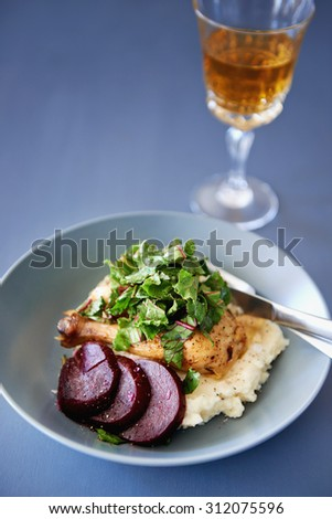 Roast chicken leg with greens spinach, beetroot and mashed potato as a healthy meal  - stock photo