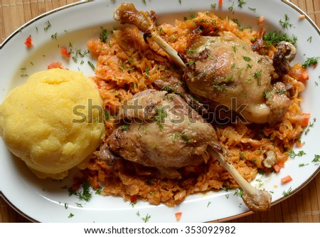 Roast duck legs with white cabbage and polenta - stock photo