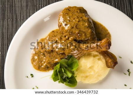roast duck with mashed potato on the plate