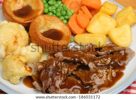 Roast lamb Sunday dinner with Yorkshire puddings. - stock photo