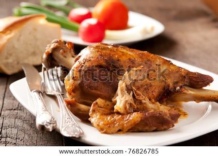 Roast Leg of Lamb on a plate - stock photo