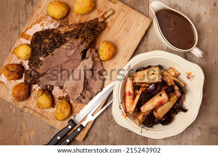 roast leg of lamb with roast vegetables and gravy