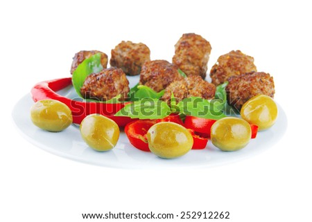 roast meat balls on basil over blue dish - stock photo