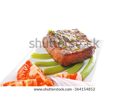 roast meat served with tomato on white dish - stock photo
