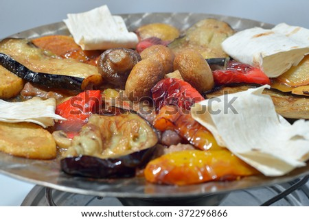 roast mushrooms and vegetables (Georgian cuisine) - stock photo