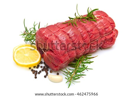 roast of beef with rosemary on white