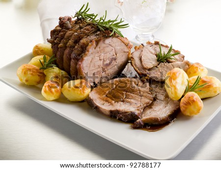 roast of veal with potatoes - stock photo