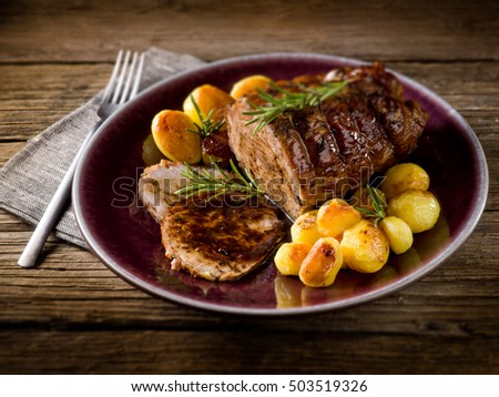 roast of veal with potatoes, selective focus