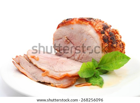 Roast pork and slices isolated on white - stock photo