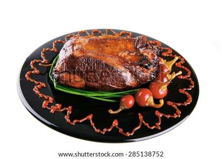 roast red beef meat bbq bloc served on black plate  with green chives and red hot pepper on black plate isolated over white background - stock photo