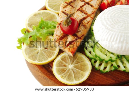 roast salmon fillet with cheese and tomatoes - stock photo