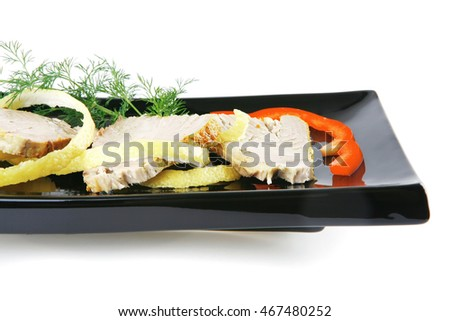 roast tuna slices served on white porcelain plate