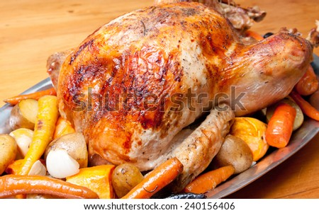 roast turkey dinner with seasonal vegetables for a family holiday meal - stock photo