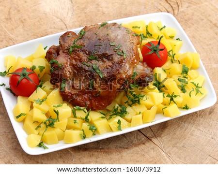 Roast turkey with potatoes - stock photo