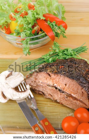 roastbeef on transparent plate and salad bowl - stock photo