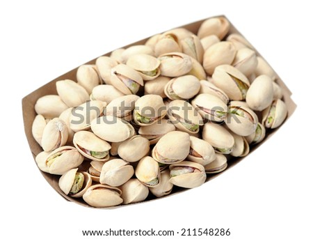 roasted and salty pistachio in bucket isolated on white - stock photo