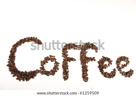 Roasted beans spelling the word coffee on white background - stock photo