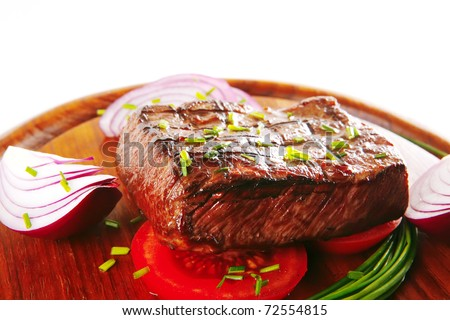 roasted beef fillet served with wooden on plate