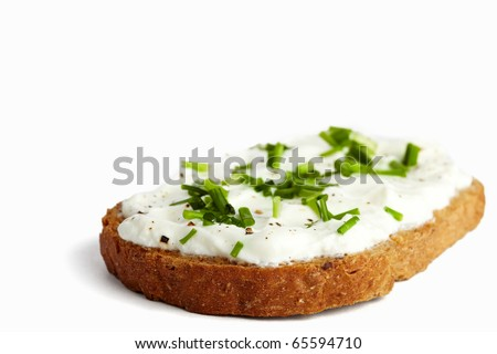 Roasted bread with curd / cream cheese and chives, isolated on white - stock photo