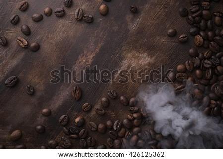 Roasted cafe beans on dark background - stock photo