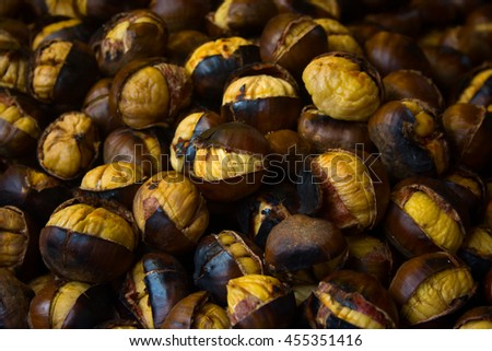 Roasted chestnuts background - stock photo
