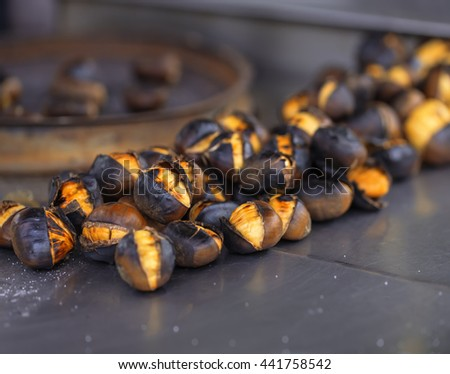 Roasted chestnuts close up in natural light. - stock photo